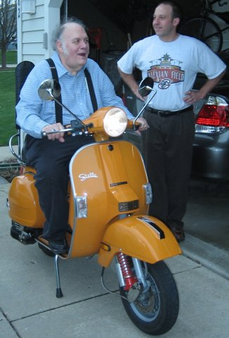 orange Stella scooter with Dennis